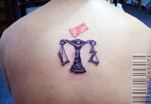 A very cool Libra tattoo design. Notice the L and Z on the two sides of the