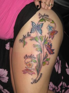 butterfly & flowers tattoo on foot