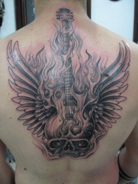 guitar fire skull wings tattoo