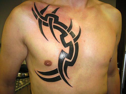 chest lettering tattoos for men. Tribal for men.