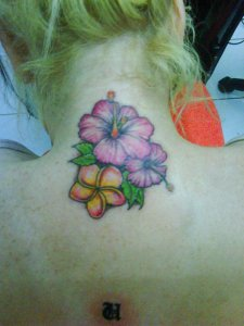 flower lower back tattoos for girls